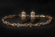 женский золотой браслет с фианитами и золотые серьги комплект